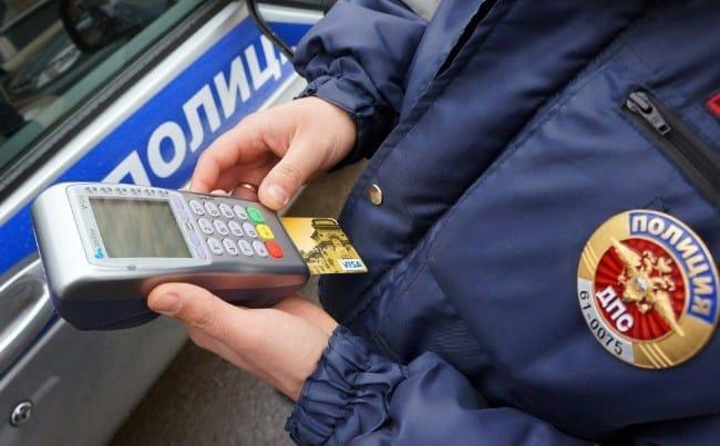 Рис 1. При проведении рейдов должник может погасить имеющийся штраф на месте остановки сотрудниками ГИБДД.