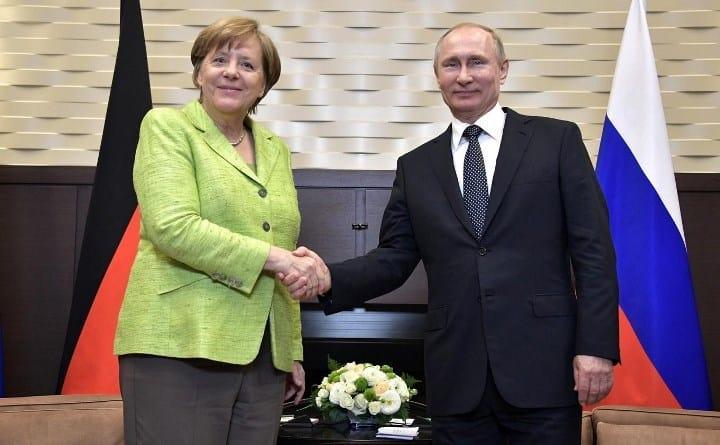 Рис. 2. В. Путин и А. Меркель